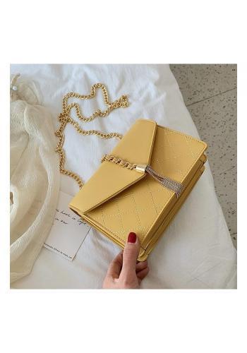 Dámska elegantná kabelka so zlatými doplnkami v žltej farbe