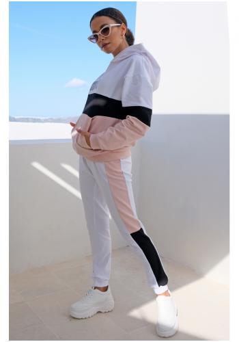Dámske tepláky v bielej farbe s púdrovo-čierným pásom na bokoch