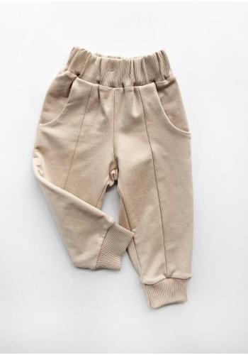 Bavlnené detské nohavice béžovej farby