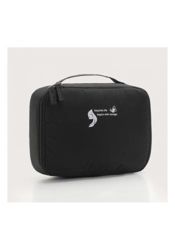 Dámska kozmetická taška v čiernej farbe
