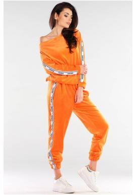 Velúrové dámske tepláky oranžovej farby s kontrastnými pásmi